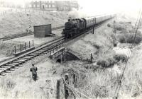 Wemyss Bay - Glasgow train approaching west end in pouring rain. Cartsburn Twin Tunnels.<br><br>[G H Robin collection by courtesy of the Mitchell Library, Glasgow&nbsp;31/08/1963]