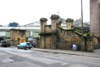 Entrance to Waverley station from Calton Road in July 2006. At one time a choice existed at the top of the steps between either a right turn onto the footbridge leading into the station itself, or straight ahead for the elevated walkway across to Jeffrey Street, the supporting stone pier and part of the framework of which can still be seen here. The gated compound was once used by the Royal Mail. [See image 44229] <br><br>[John Furnevel&nbsp;30/07/2006]