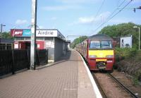 Looking west along the through platform at Airdrie station in June 2006 with a Drumgelloch - Helensburgh service about to leave.<br><br>[John Furnevel&nbsp;11/06/2006]