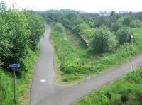 Remains at the site of Westcraigs station looking east towards Armadale in June 2006. The 1862 station, built by the Bathgate & Coatbridge Railway, was located on the southern fringes of the village of Blackridge in West Lothian and one and a half miles north of Harthill. Westcraigs lost its passenger service in 1956. [The station appeared in some timetables as <I>Westcraigs for Harthill</I>.] Plans are afoot to build a new station here as part of the Airdrie - Bathgate reopening, although the new station would be named Blackridge, rather than Westcraigs. <br><br>[John Furnevel&nbsp;12/06/2006]