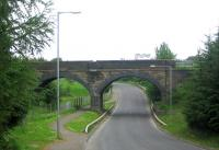 Viaduct to the east of Caldercruix station - view looking north along the B825 in June 2006. The sculpture protruding above the parapet is called STEAM for some reason.<br><br>[John Furnevel&nbsp;02/06/2006]