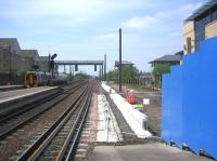 Looking west from Haymarket platform 1 on 8 June 2006 with work in progress on the run-in to the new platform 0 which will take over part of the station car park (makes a nice change) behind the blue barrier.<br><br>[John Furnevel&nbsp;08/06/2006]