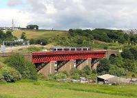 Train for Edinburgh Waverley on Jamestown Viaduct on a sunny day in June 2006. On the left is the M90 motorway and Ferry Toll Park and Ride can be seen through the viaduct. <br><br>[John Furnevel /06/2006]