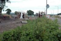 The replacement road overbridge for the Hilton Road level crossing takes shape just west of the former Kincardine Junction. View looks east.<br><br>[Ewan Crawford&nbsp;24/06/2006]