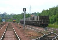 View west from Halbeath level crossing in June 2006 with a locomotive in the process of running round a train of empties in Halbeath sidings. The east end of Queen Margaret station can be seen through the bridge on the left.  <br><br>[John Furnevel&nbsp;13/06/2006]