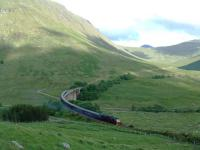 The Royal Scotsman heads north on the Horseshoe curve. The 47 accelerates out of the speed restriction over the viaducts.<br><br>[Ewan Crawford&nbsp;01/07/2006]
