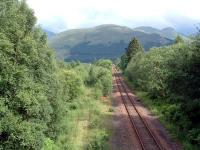 Crianlarich Lower Junction looking east. On the left is the (very overgrown) cut-back line to Callander and to the right the WHL link to the Oban line. The line on the left may re-open to Crianlarich Lower for timber traffic.<br><br>[Ewan Crawford&nbsp;01/07/2006]