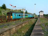 Leeds bound train passes the disused bay platform at the east end of Hellifield station.<br><br>[Ewan Crawford&nbsp;03/06/2006]