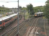 A diverted Queen Street - Waverley service about to come off the sub at Portobello on 9 July 2006, just as a GNER train for Kings Cross passes southbound on the ECML.<br><br>[John Furnevel&nbsp;09/07/2006]