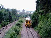 Heading north through the former Dinmore station heading for the twin tunnels.<br><br>[Ewan Crawford&nbsp;10/07/2006]