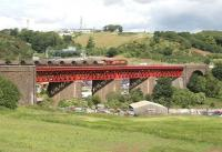 Coal train running onto Jamestown Viaduct on the approach to Inverkeithing in June 2006. In the background is the M90 Motorway and cars parked in the <I>Ferry Toll Park and Ride</I> facility can be seen below the viaduct. On the hill above stands part of the former MoD Pitreavie Maritime HQ (the main underground facility having been closed down and sealed in 1995.)   <br><br>[John Furnevel 20/06/2006]